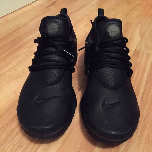 Woman's Nike Prestos triple black