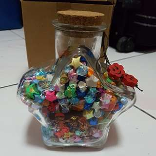 Folded stars in a star shape jar