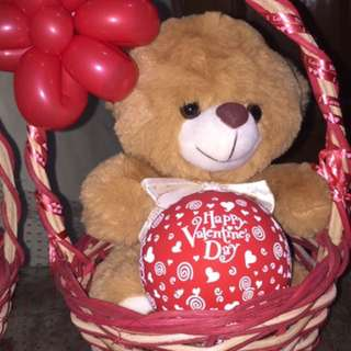 teddy bear with bouquet of balloons
