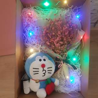 ($40) baby breath with doreamon plushie