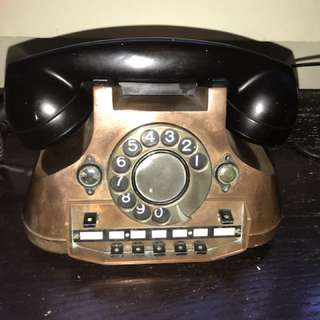 Antique copper rotary phone