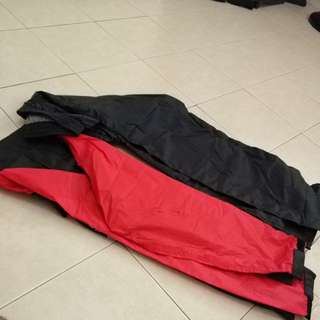 Red and black raincoat size L