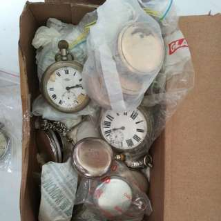 Box full of pocket watches.