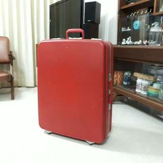 vintage fire engine red Sunco suitcase w 4 wheels
