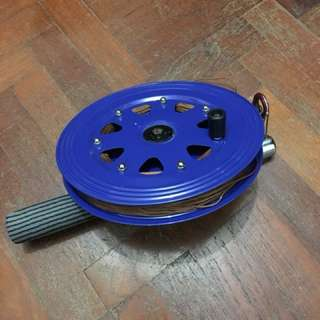Kite reel with an extra ball of thread
