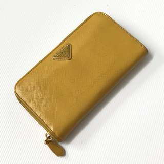 Preloved auth prada zippy wallet yellow mustard
