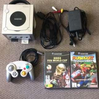 Gamecube silver with 2 games(Mario and FIFA)