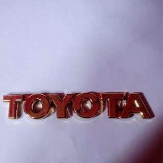 Toyota gold emblem