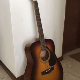 Acoustic guitar - it is almost brand new and rarely used and can be negotiable