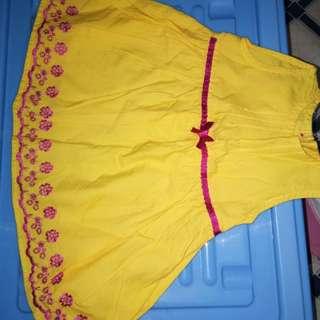 Vibrant yellow baby girl dress