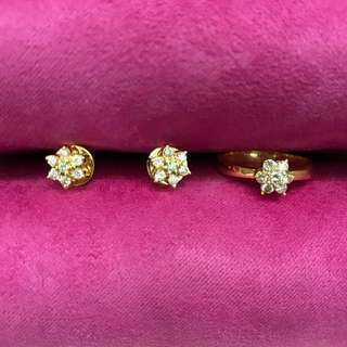 Diamond cluster earrings and ring set in 14 karat yellow gold 5.5 grams
