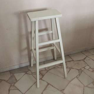 Old used tall wooden chair