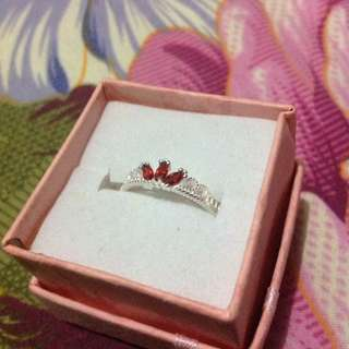 Authentic silver ring with crown-designed red stone;