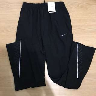 Nike Dri-Fit Jogging Pants with Zipper Pockets for Men (Large)