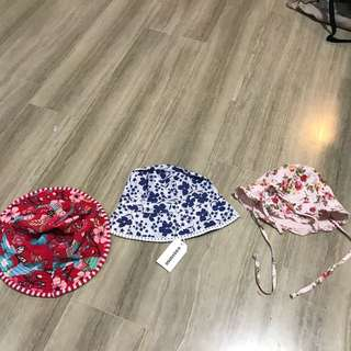 Baby girl hats, unused / barely used. One is a reversible swim hat. From 3 months to 1 yr old
