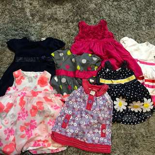 Baby dresses, 6-12 months. H&M, Carter's. Barely used. 7 pieces