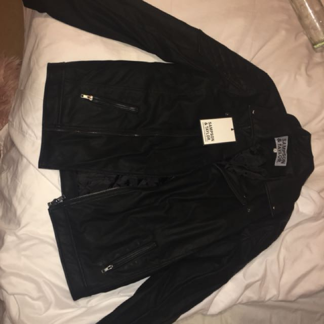 BRAND NEW leather jacket with tags