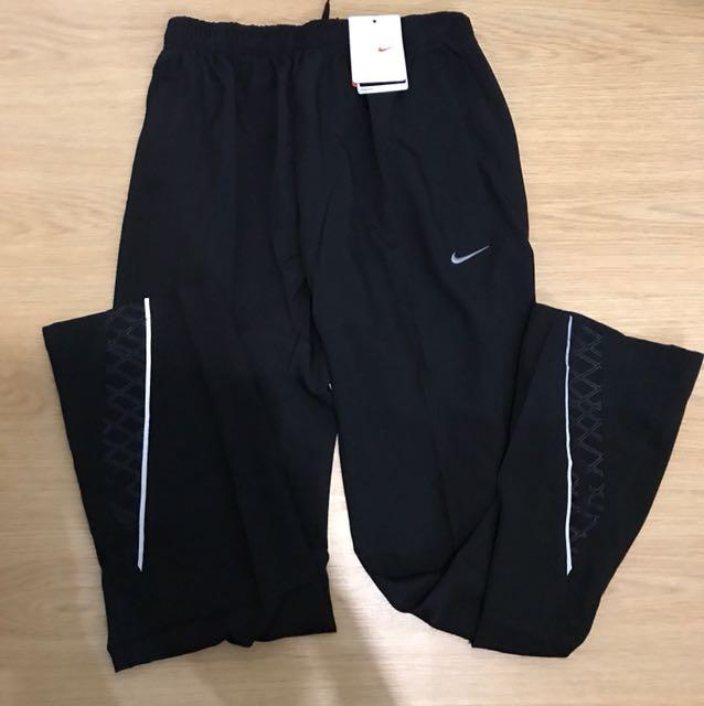 Nike Dri-Fit Jogging Pants with Zipper Pockets for Men (Large)