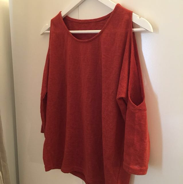 Orange knit top with cold shoulders