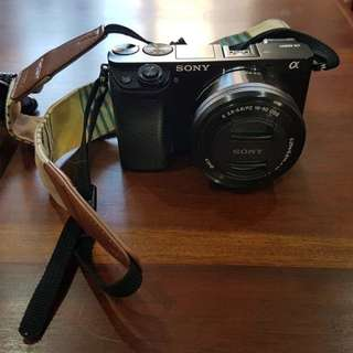 Sony Alpha A6000 Camera + lens + waterproof case and extra