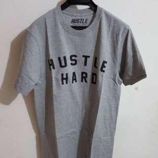 T-Shirt Hustle abu ( S/M/L )