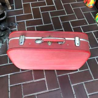 Vintage red  travel suitcase