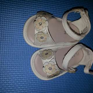 Place white sandals