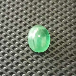 E) Emerald carbocheon from Namibia. Nice green.