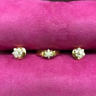 4.6 grams diamond cluster earrings and ring in 14 karat yellow gold. Earrings back (earrings nut) 10 karat