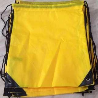 Yellow drawstring bag (nylon)