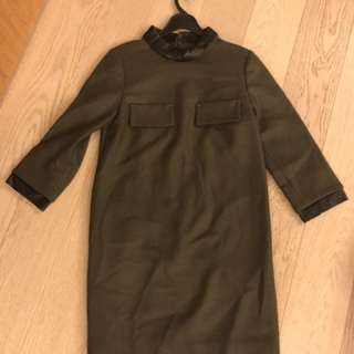 Dark green one piece dress with leather details