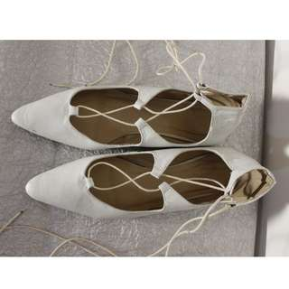 White lace-up flats