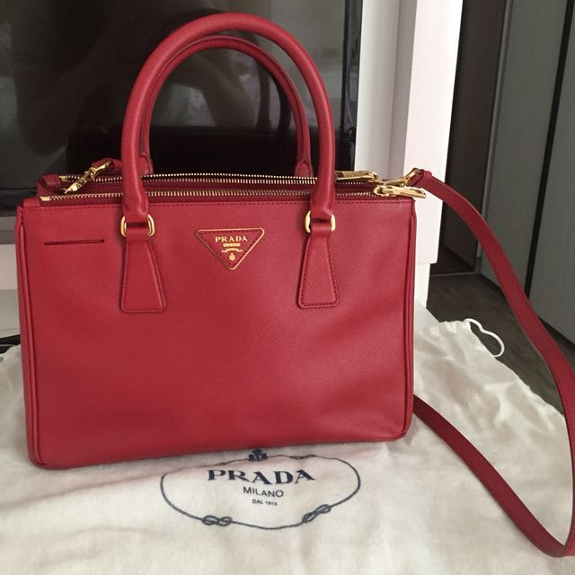 0251b0010049 Prada Saffiano red handbag, Luxury, Bags & Wallets on Carousell