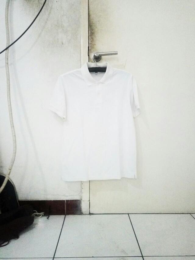 Uniqlo polo size L putih bersih
