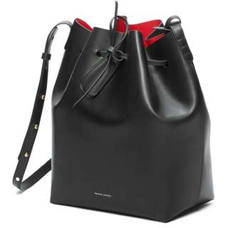 Black bucket bag with red lining