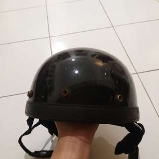Old school riding helmet with earflaps