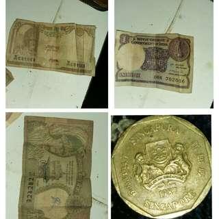 Nepali 10 rupaiya Indian 1 rupee  Singapore 1 dollar coin and Nepali 2 rupaiya