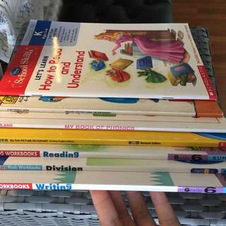 Primary students books in Chinese, English, Maths and Science subjects