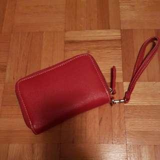 Woman's red clutch wallet