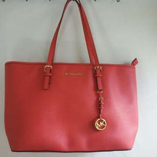#50% Michael kors jet set travel coral.