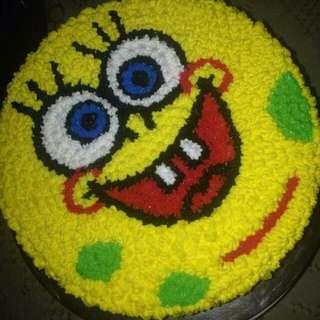 Frosting cake with cartoon desig