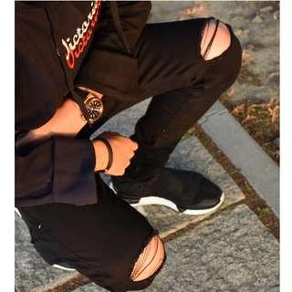 黑色刀割牛仔褲