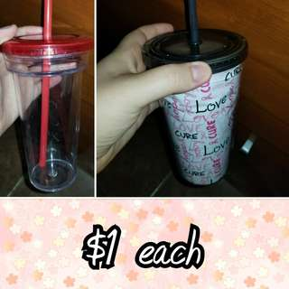 Plastic cups with straws