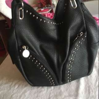 Black purse with silver hardware. In perfect condition willing to change the price
