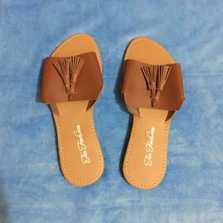 Brown tassel slip on