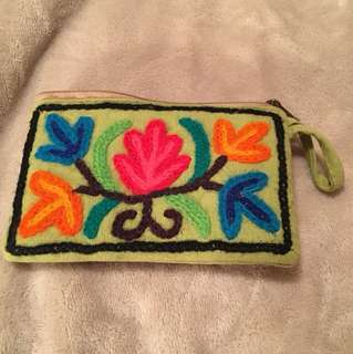 Embroidered and lined purse