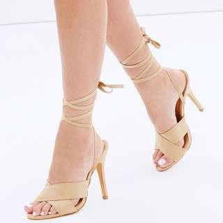 Nude tie up heels