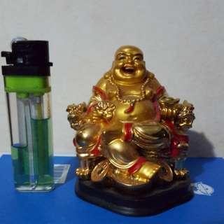 Laughing Buddha sitting on( Dragon Chair )