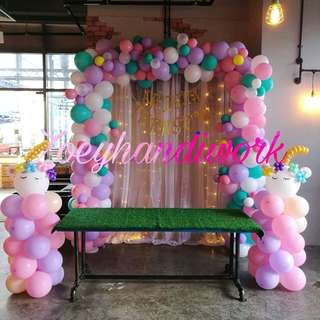 Sweet, fancy and unique pastel balloon decoration-- Unicorn themed balloon arch, balloon columns & fairy lights backdrop rental