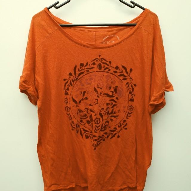 Burnt orange floral top